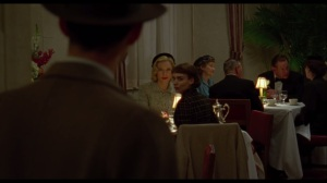 Carol- Jack Taft, played by Trent Rowland, finds Therese Belivet, played by Rooney Mara, having dinner with Carol Aird, played by Cate Blanchett