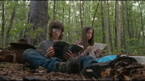 The Next World- Carl reads a comic book while Enid looks at a map