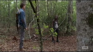 The Next World- Michonne and Spencer in the woods