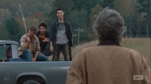 East- A group of Saviors confront Carol