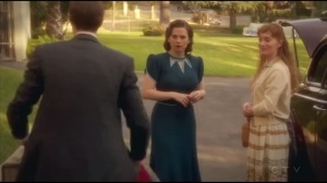 Hollywood Ending- Edwin happily gets Peggy's bags as he prepares to drive her
