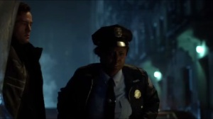 Mr. Freeze- Victor Fries, played by Nathan Darrow, shows an officer his trunk