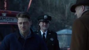 Prisoners- Jim, Falcone, and Bullock on a bridge