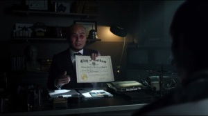 This Ball of Mud and Meanness- Hugo Strange gives Penguin a certificate declaring him sane