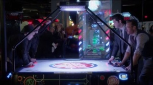 Tragedy of the Commons- Doug and Clyde play air hockey with two band members