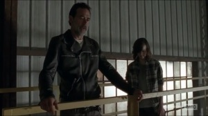 sing-me-a-song-negan-and-carl-stand-before-the-saviors