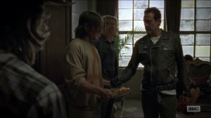 sing-me-a-song-negan-receives-food-from-daryl