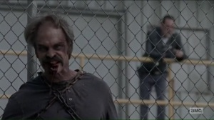Worth- Simon on the fence as a walker- AMC, The Walking Dead