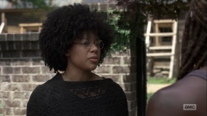 The Obliged- Nora, played by Tamara Austin, talks with Michonne about the tomatoes- AMC, The Walking Dead