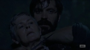 Warning Signs- Jed holds a gun to Carol's throat- AMC, The Walking Dead