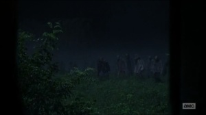 Evolution- Walkers approach the shed- The Walking Dead, AMC