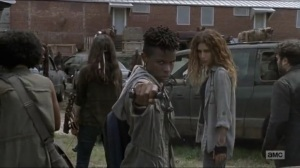 Stradivarius- Kelly kills a walker with her slingshot- The Walking Dead, AMC