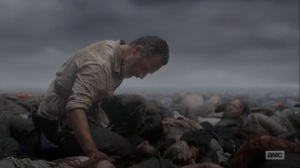 What Comes After- Rick on the pile of dead bodies- The Walking Dead, AMC