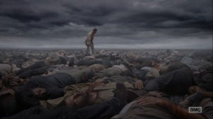 What Comes After- Rick walks atop a pile of dead bodies- The Walking Dead, AMC