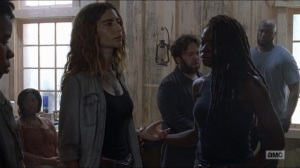 Who Are You Now- Michonne examines Magna's left hand- The Walking Dead, AMC