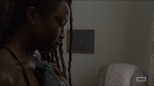 Who Are You Now- Michonne holds one of Rick's shirts- The Walking Dead, AMC