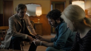 The Big Never- Roland shows Tom and Lucy the photos of the toys found in the woods- HBO, True Detective