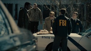 The Big Never- Wayne, Roland, and detectives go over toys found in bag- HBO, True Detective