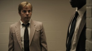 The Great War and Modern Memory- Roland gives Wayne a look after they talk with Amelia- HBO, True Detective