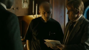 The Hour and the Day- Roland shows the pastor some photos of the straw dolls- HBO, True Detective