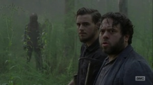 Adaptation- Alden and Luke surrounded by Whisperers- AMC, The Walking Dead