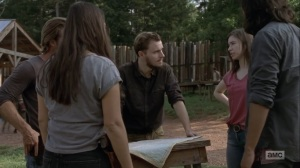 Adaptation- Alden, D.J., Enid, Tara, and Marco, played by Gustavo Gomez, consider looking for Michonne- AMC, The Walking Dead