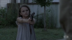 Adaptation- Judith points a gun at Negan- AMC, The Walking Dead