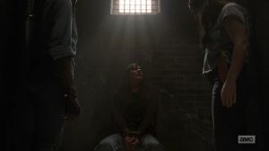 Adaptation- Michonne, Tara, and Daryl interrogate the prisoner- AMC, The Walking Dead