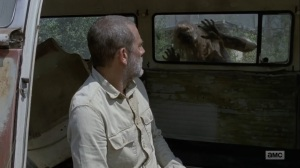Adaptation- Walker interrupts Negan's snack time- AMC, The Walking Dead