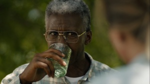 Now Am Found- Wayne drinks a glass of water while eyeing Julie Purcell- HBO, True Detective