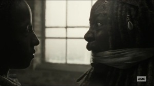 Scars- Jocelyn watches as Michonne gets X burned into her back- AMC, The Walking Dead