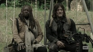 Scars- Michonne and Daryl rest on a swing set- AMC, The Walking Dead