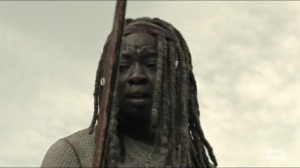 Scars- Michonne looks at her bloody sword- AMC, The Walking Dead