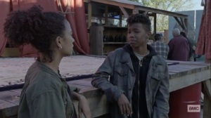 The Calm Before- Kelly signs to Connie about her concern- AMC, The Walking Dead