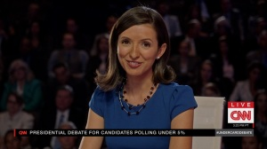 Pledge- Brie Ramachandran as debate moderator- Veep, HBO