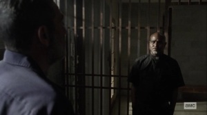 Lines We Cross- Gabriel visits Negan's cell- AMC, The Walking Dead