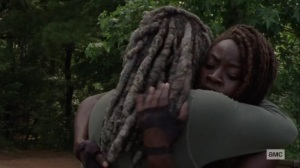 Silence the Whisperers- Ezekiel and Michonne hug- AMC, The Walking Dead