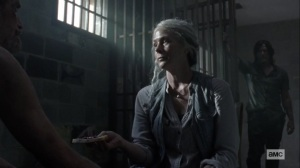 Open Your Eyes- Carol offers bread to the Whisperer prisoner- AMC, The Walking Dead