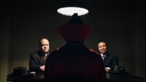 This Extraordinary Being- Jerry and Art, played by Adam Drescher and Erik Palladino, question Hooded Justice- HBO, Watchmen