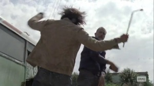 What It Always Is- Negan bashes Brandon's head with a stone- AMC, The Walking Dead