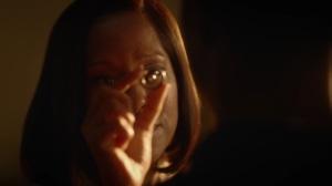 A God Walks Into a Bar- Angela holds the Tachyon device- HBO, Watchmen