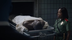 A God Walks Into a Bar- Angela pulls out the body of Calvin Jelani- HBO, Watchmen