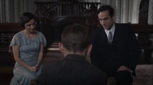 A God Walks Into a Bar- Crookshanks and Phillips give Jon a Bible- HBO, Watchmen