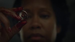 An Almost Religious Awe- Angela takes hydrogen atomic symbol out of Cal's skull- HBO, Watchmen