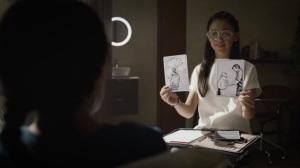 An Almost Religious Awe- Bian shows Angela two images- HBO, Watchmen