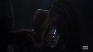 What We Become- Virgil offers Michonne a glass of water- AMC, The Walking Dead
