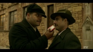 The Land of Taking and Killing- Gaetano holds a tin of teeth- Fargo, FX