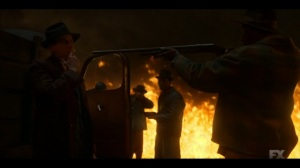 The Pretend War- Calamita surrounded by Loy's men in the ring of fire- Fargo, FX