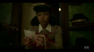 The Pretend War- Ethelrida examines a bracelet and newspaper clippings- Fargo, FX