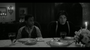 East West- Satchel and Rabbi at the table for dinner- Fargo, FX